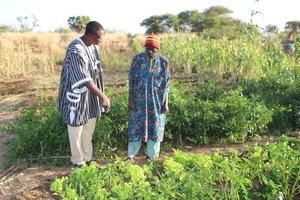 INERA PhD and Farmer in desert village