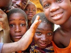 Children attending school thanks to village basin