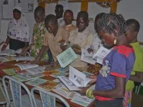 Children examine the donated books
