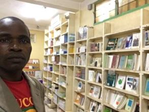 FAVL representative in bookstore in Ouaga