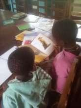 Reading in Kitengesa library, Uganda