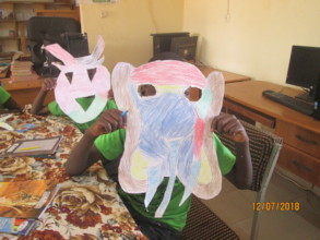Making masks in summer reading camp