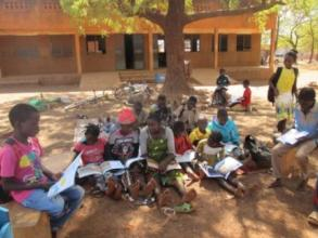 Readers using the mobile library in a school
