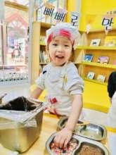 Gabby enjoying cooking class at preschool!