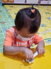 Harmony making rice balls at preschool