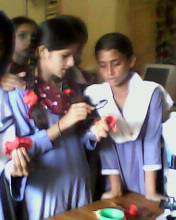 Girls conducting a science experiment