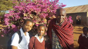 Debora -standing with parent whose child performed