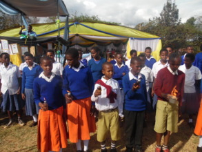 Gongali students turning OFF Kerosene Lamps