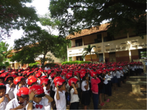 Students learn how to wear their helmets properly.