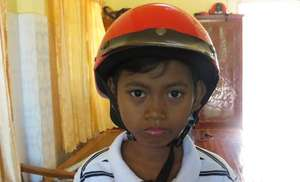 Phada, a child protected from injury by a helmet