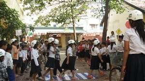 Students practice crossing the road safely
