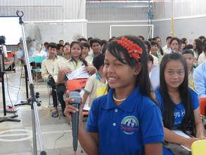 Students discuss passenger helmets in Cambodia