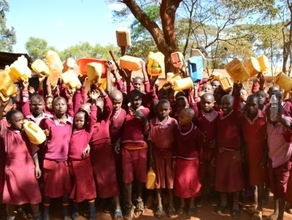 School kids displaying empty containers of water