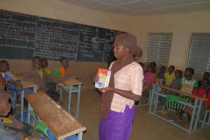Aicha in school with 'mobile library' Dec 2017