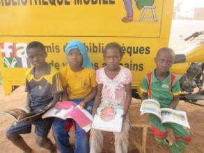 Kids reading, mobile library, Burkina