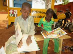 Students reading by mobile library