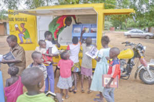 Schoolchildren gather around the mobile library