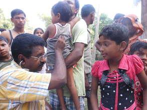 International Medical Corps doctor examining child
