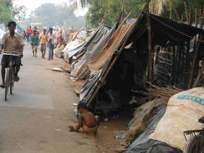 Displaced people in temporary road-side camps