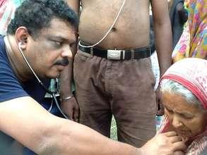 Dr. Santhosh caring for a patient