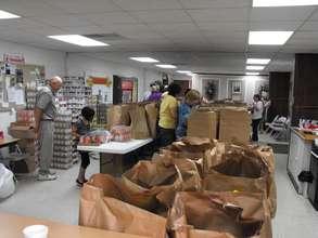 Preparing relief food - packages for kids