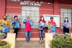 Teachers and AAI volunteers prepare relief packs
