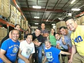 Happy volunteers pack donations in Virginia