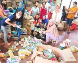 Teachers and volunteers pack relief supplies