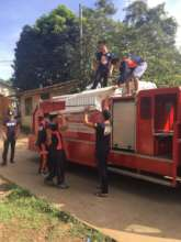 Fire fighters in Jolo help to rebuild schools
