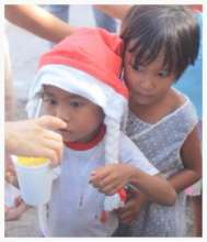 Child typhoon victims being fed