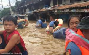 Carrying children through flood waters
