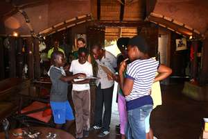 The children take a tour of a game lodge