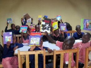 Pupils enjoying their new classrooms and books