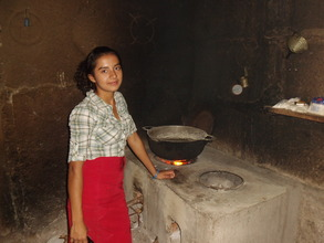 Dailia J. with her improved cookstove