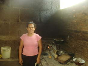 Juana M with her old traditional fire