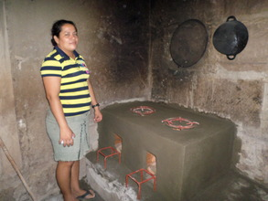Elsa G. with her new Emelda improved cookstove