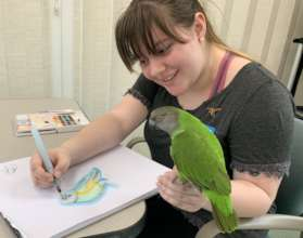 TALENTED VOLUNTEER TORI PAINTS OUR MANGO!