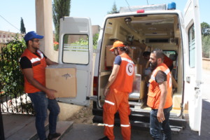 Delivering aid to a clinic serving Syrian refugees