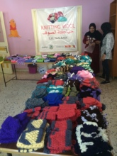 Scarves, hats, and mittens made by refugee women