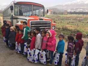 Children taking home their new winter clothes