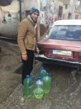 Taking home gas for his family's heater