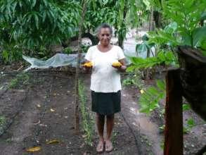 Dona Bertulia showing her crop.