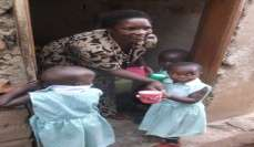 Mama Rachel serving porridge and eggs to kids.
