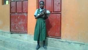 Irene at the door way of her class