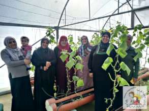 Proud women in one of their rooftop greenhouses