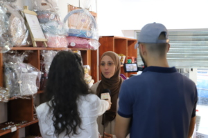 One of the supported woman explaining her business