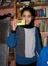 Proud of her library card!