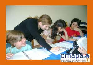 Teachers working with the kids of the first level