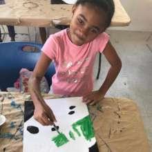 "Child at the ""Hello Art"" art class"