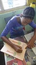 girl making a book